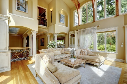 Impressive high ceiling living room with antique furniture, columns and balcony